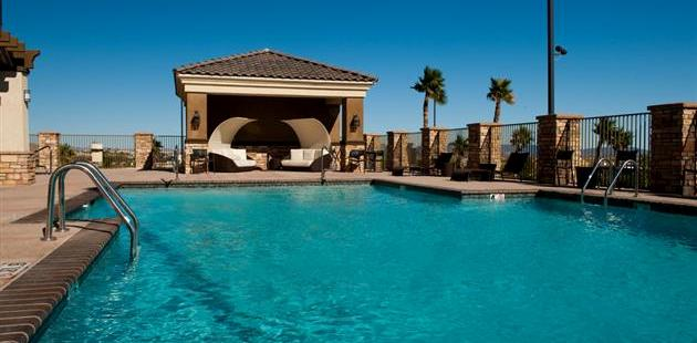 Outdoor pool with cabana seating area