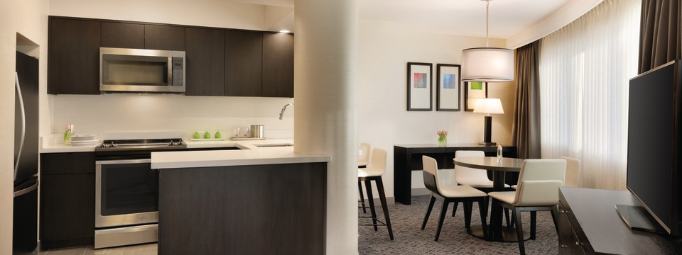 Suite featuring a dining area and a full kitchen with an oven, microwave and refrigerator