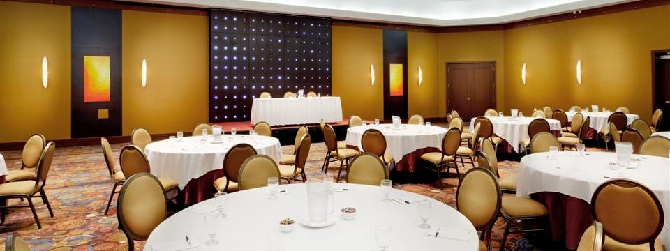 Ballroom with round tables covered in white linens