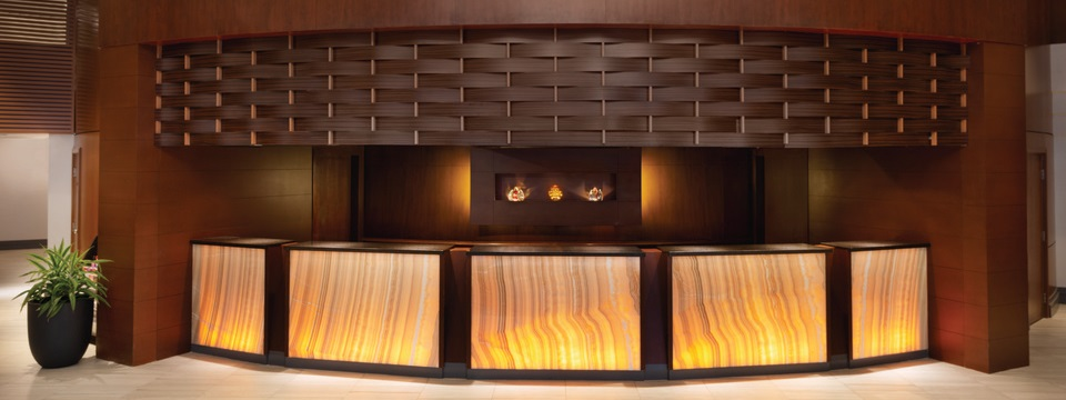 Reception desk with rich wood accents and soft lighting