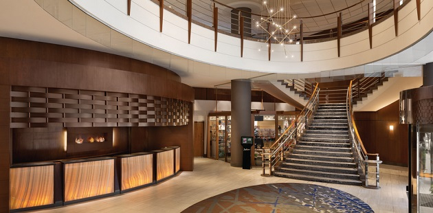 Spacious lobby with view of staircase and reception desk