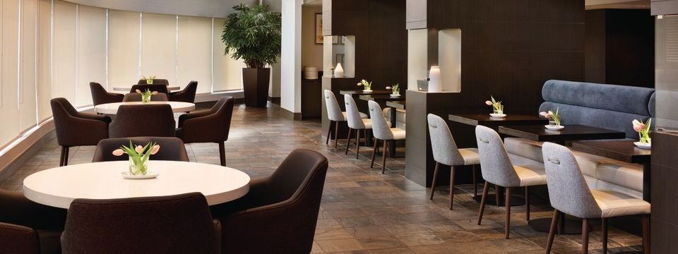Modern restaurant with tables, chairs, booths and floral centerpieces