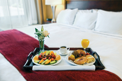Breakfast in bed featuring a fruit and pastries platter