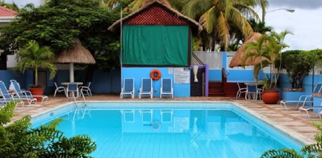 Sparkling blue outdoor pool at our seaside hotel in Belize