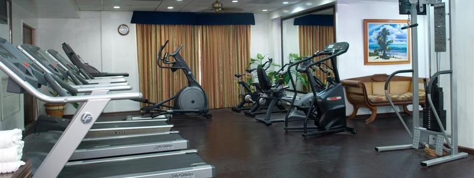 Hotel fitness center with treadmills in Belize City