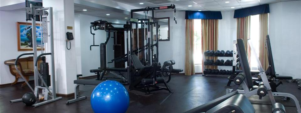 Belize City hotel's fitness center with a yoga ball and free weights