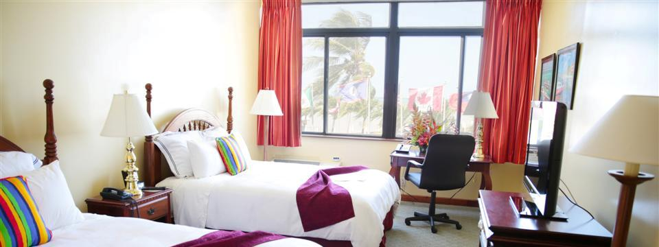 Colorful Belize City hotel room with views of the ocean