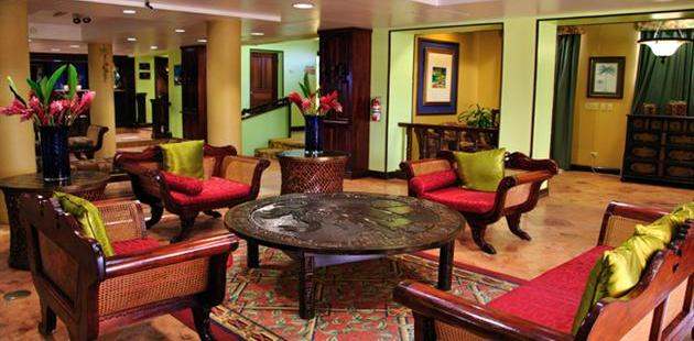 Comfortable seating in our Belize City hotel's warm lobby