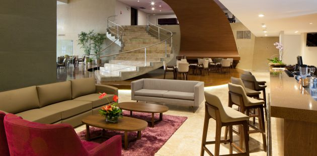 Spacious hotel lobby with bar and lounge area