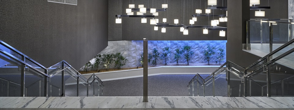 Hotel lobby with staircase and modern lighting