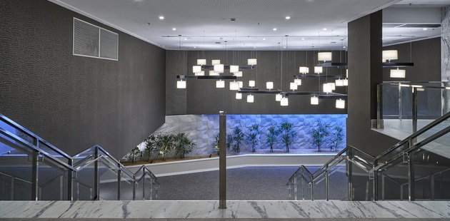 Lobby of Radisson Hotel Barra with modern lighting and staircase