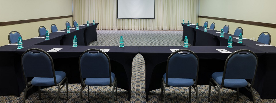 U-shaped meeting room setup in open hotel event venue