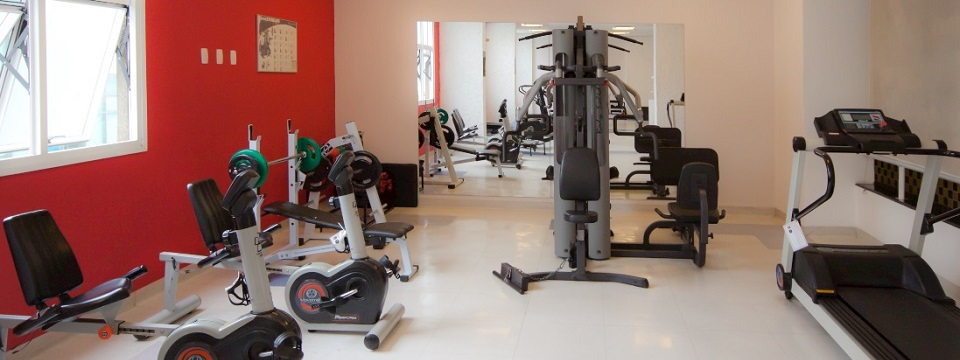 Hotel fitness center with treadmill and weight machines