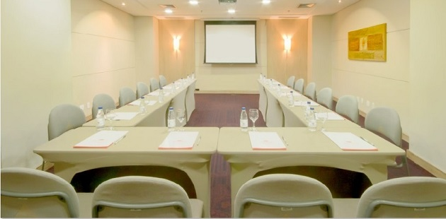 Boardroom with U-shaped table-and-chairs setup