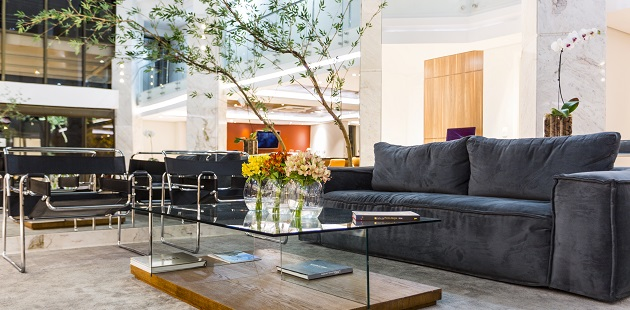 Modern hotel lobby with comfortable seating and flower bouquets
