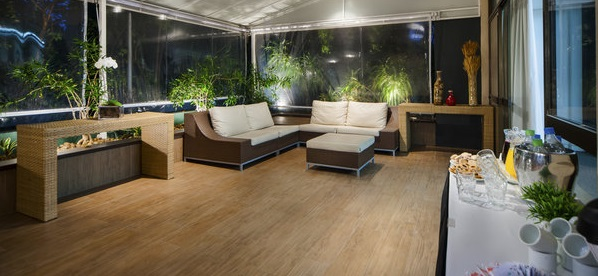 Meeting room with couches, large windows and greenery