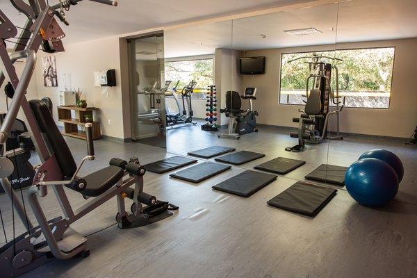Fitness center with weight machines, free weights and yoga mats