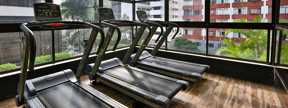 Treadmills next to windows looking out on city