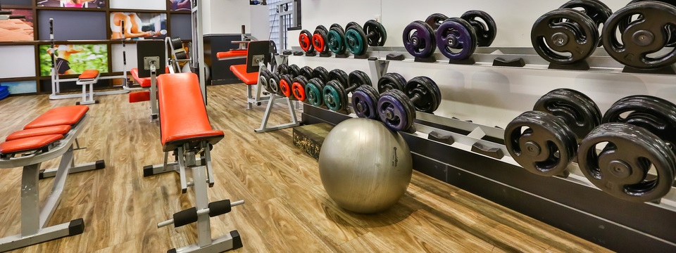Fitness center with weight-lifting equipment