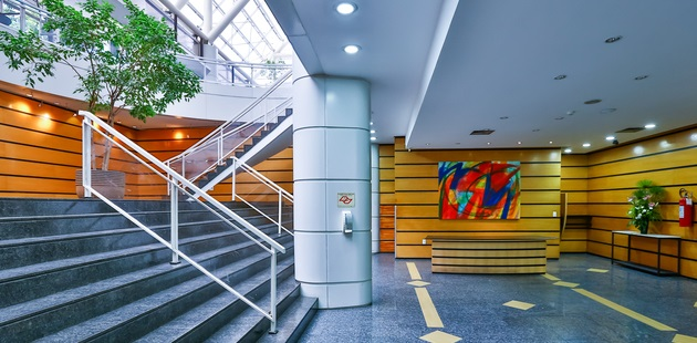 Hotel lobby with staircase and modern artwork