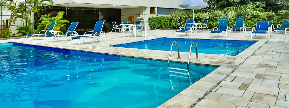 Bright blue water and blue lounge chairs at outdoor pool