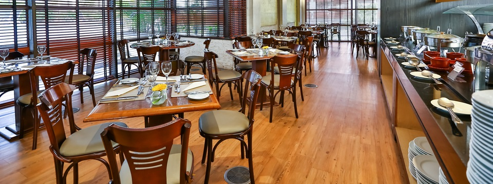 Wooden tables and chairs at All Seasons Bar and Restaurant