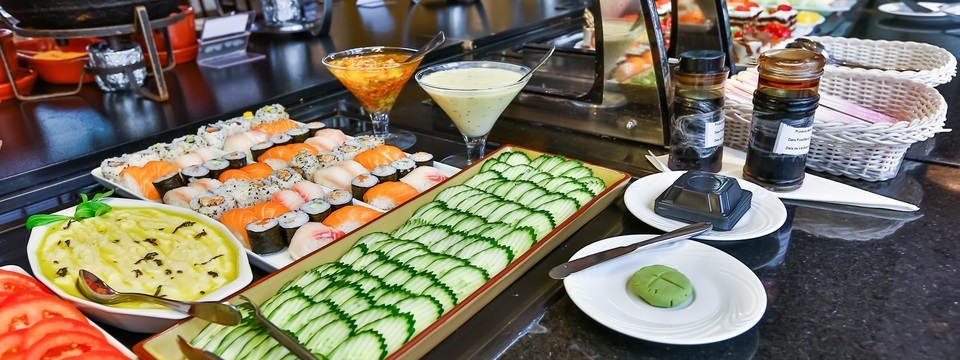 Buffet with vegetables and sushi