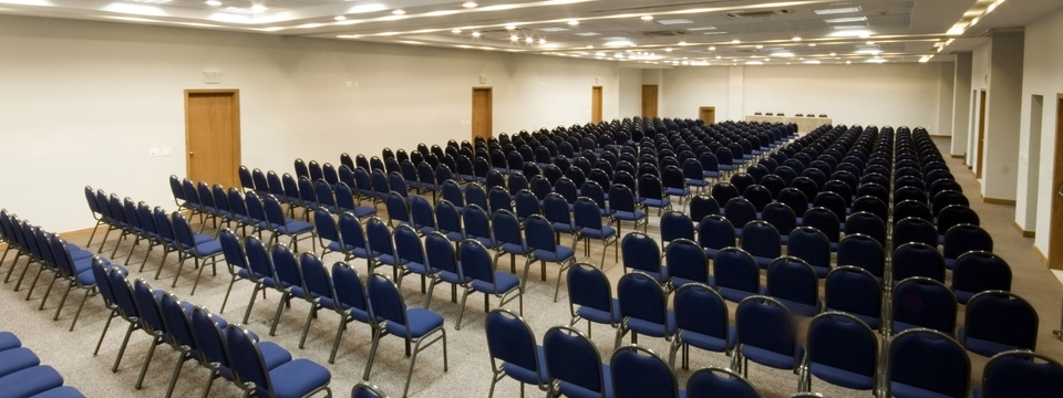 Spacious meeting room filled with rows of chairs