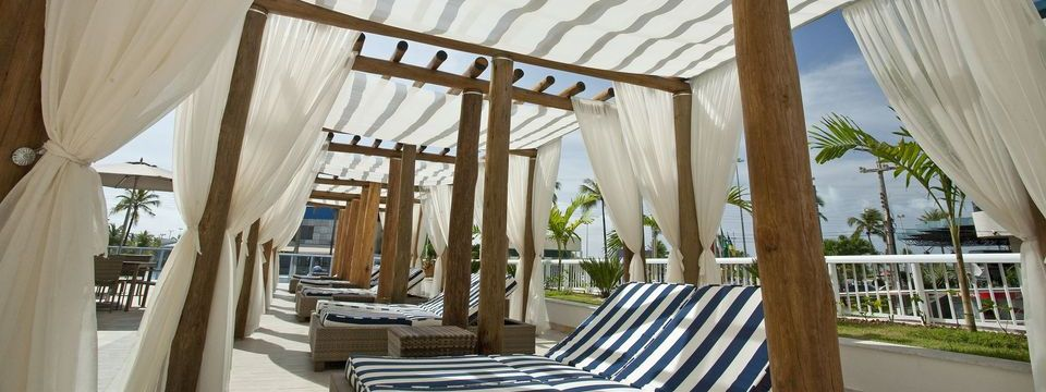 Lounge chairs underneath awnings