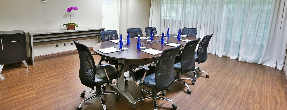 Intimate meeting space with ergonomic chairs and bottled water