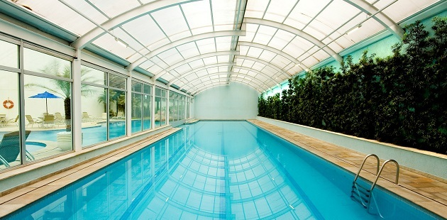 Swimming pool with glass roof