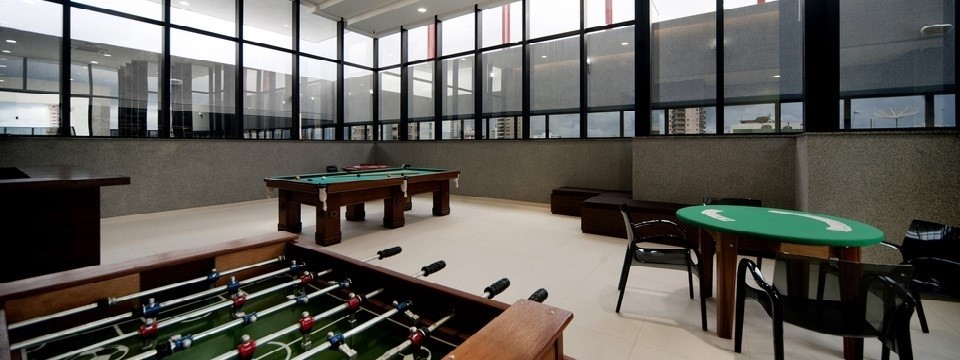 Belém hotel's game room with billiards, foosball and card table