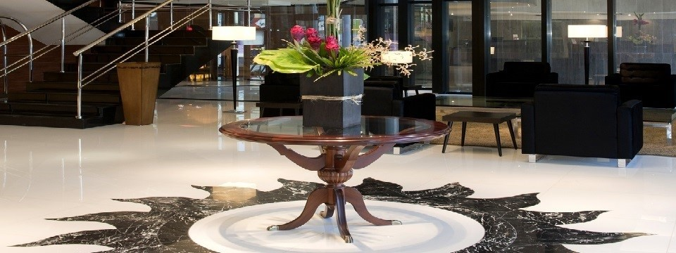 Table with floral arrangement in modern hotel lobby