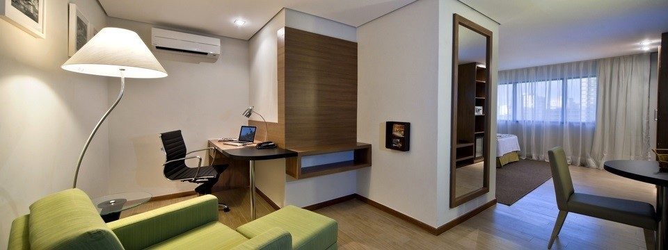 Spacious hotel suite with separate work area