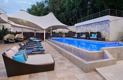 View of outdoor pool and multiple chaise lounges