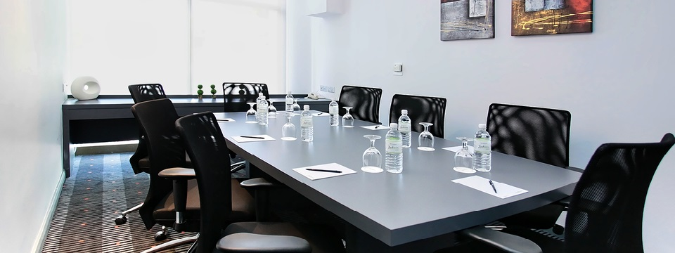Silver boardroom table at our Brunei hotel's meeting space