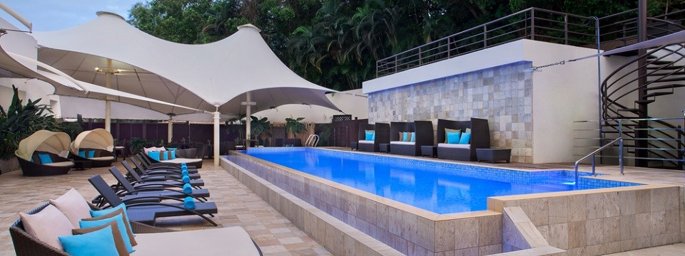 Hotel's outdoor pool with canopy and seating