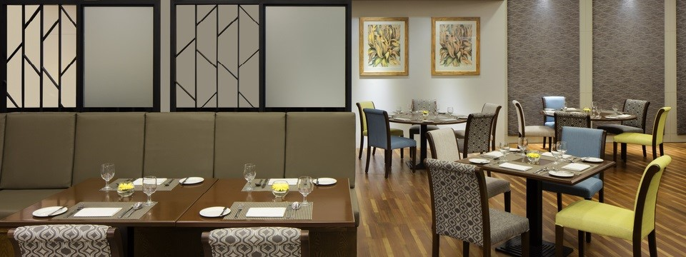 Tables and banquettes in fine dining restaurant