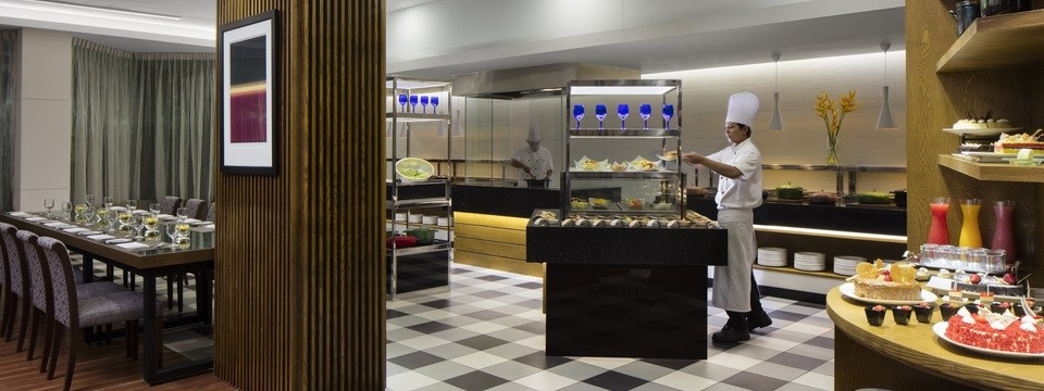 Chefs and buffet at on-site restaurant