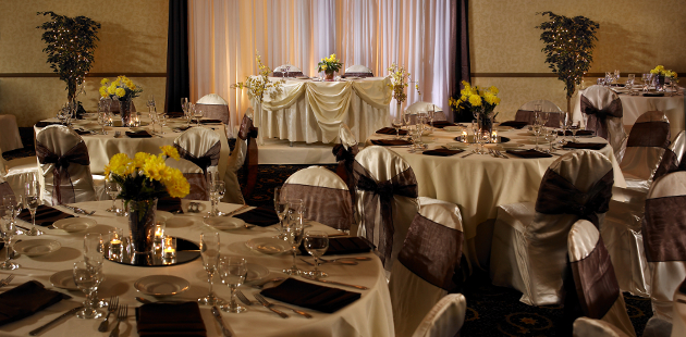 Banquet room with decorated dining tables and chairs
