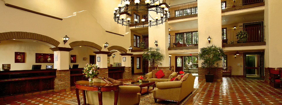 Spacious lobby with comfortable seating area and decorative chandelier
