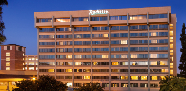 Exterior of Radisson Hotel Los Angeles Midtown at USC lit up at night
