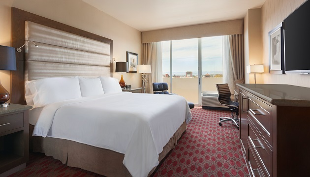 Hotel room with plush bed at Radisson Los Angeles midtown