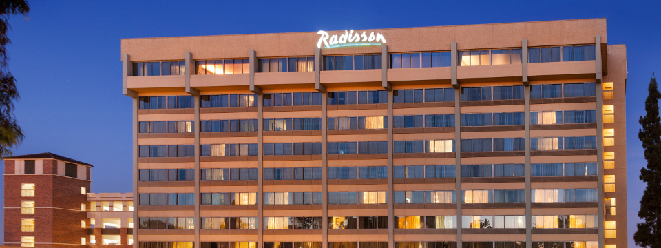 Exterior of the Radisson lit up at night