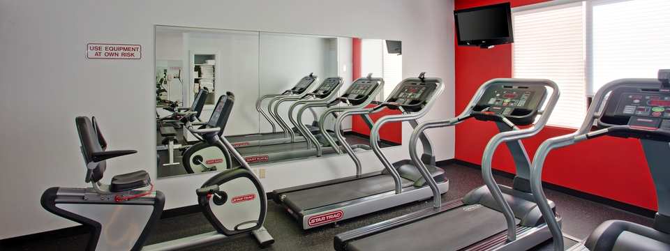 Fitness center with three treadmills and one stationary bike
