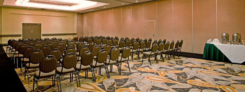 Rows of chairs facing the front of meeting room