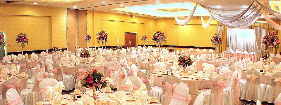 Grand Ballroom with large dining tables and scattered floral arrangements
