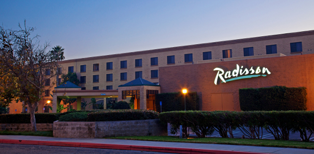 Exterior of Radisson Hotel Santa Maria at dusk