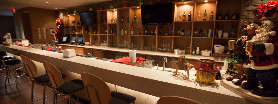 Hotel bar with holiday decor and selection of spirits