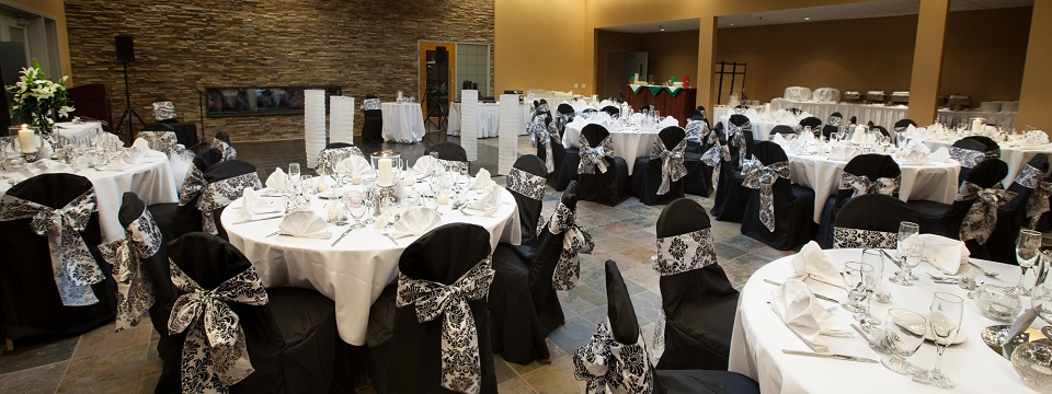 Black-and-white wedding reception with setup for live music